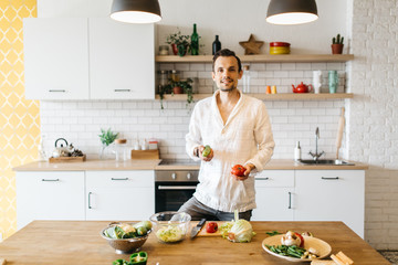 Picture of brunet cooking vegetables on table