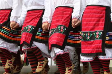 Vratsa, Bulgaria - June 24, 2018: People in traditional authentic folklore costume a meadow near Vratsa, Bulgaria Wall mural