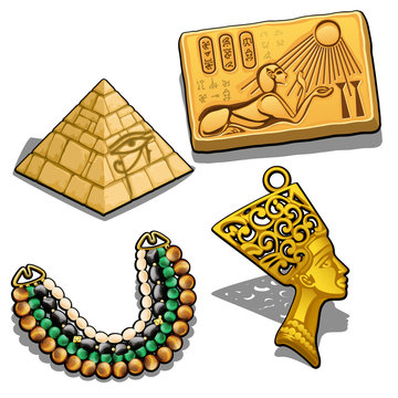 Set of attributes and jewelry on the theme of ancient Egypt isolated on white background. Golden pendant in the shape of the head of Cleopatra, miniature pyramid, necklace with semiprecious stones.