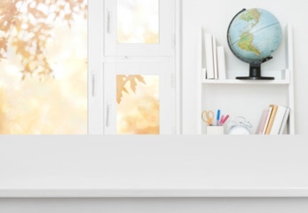 White table with blurred background of kids room and window