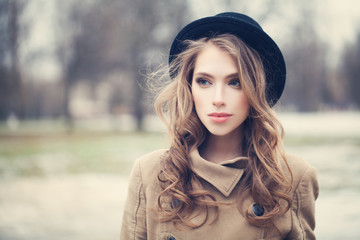 Beautiful woman with long hair outdoors, retro style portrait