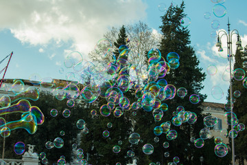 soap bubbles against sun and sky as abstract background or wallpaper