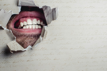 Man's mouth in paper