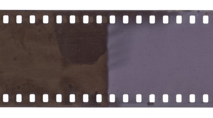 Strip of old film with dust and scratches isolated