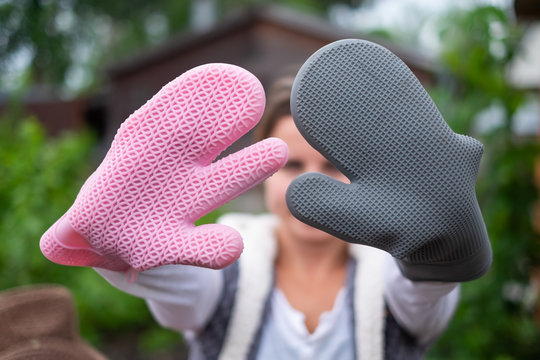 Girl wearing speacial silicone gloves for grilling