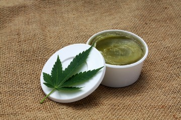 Green homemade ganja marijuana hemp ointment balm vaseline medical herbal lotion