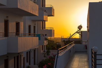 balconies at sunset