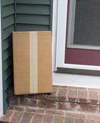 Package left on stoop of side door
