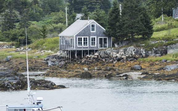 Waterfront house on stilts in Maine