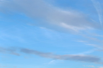Light blue sky with one cloud at summer day