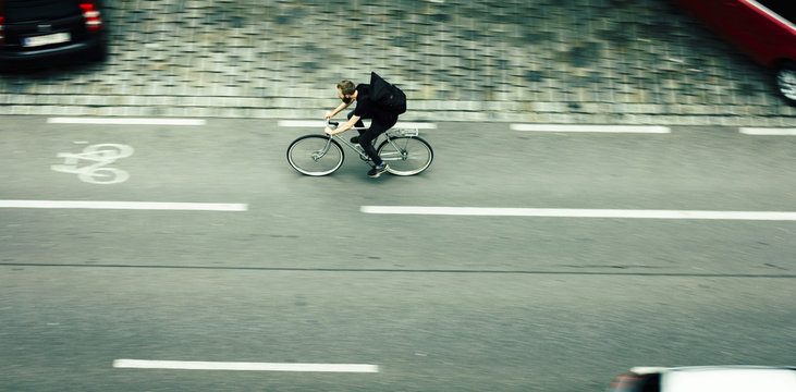 Man cycling on city street