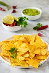 A traditional Mexican snack nachos served with sauces of guacamole, pico de gallo or salsa.