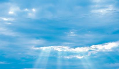 blue sky with rays of sun