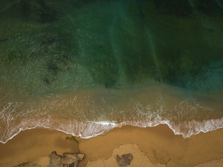 Drone shot on a beach in a summer day.