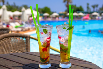 Cocktail glasses at the pool on summer holidays