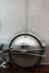 Stainless wine fermentation tank with frost formed on the side
