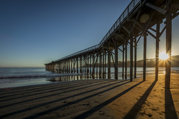 Sunset through San Simeon pier