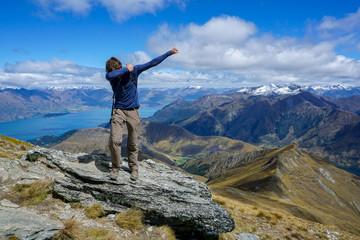 Man dabbing on the top of Ben Lomond in Queenstown New Zealand