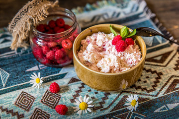 Cottage cheese with raspberry. Selective focus, horizontal. Bio/organic/natural ingredients. Healthy eating.