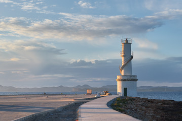 Fototapeten Leuchtturm La Savina lighthouse in the port of Formentera at sunset. Spain