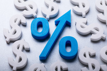 Percentage Symbol Surrounded By Many Dollar Currency Signs