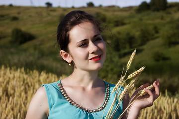 Happy girl on a wheat field