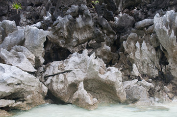 Scenic volcanic rocks shaped like fire flames near water in Philippines