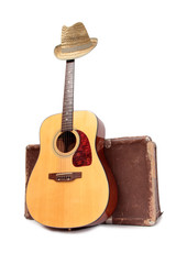Old suitcase and guitar in country style on a white background