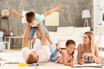 Parents spending time with children at home