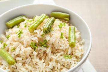 Brown rice with green beans in bowl, closeup