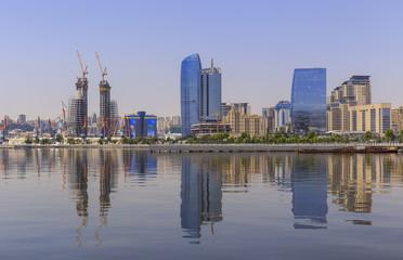 Reflection of buildings in the Caspian Sea in Baku