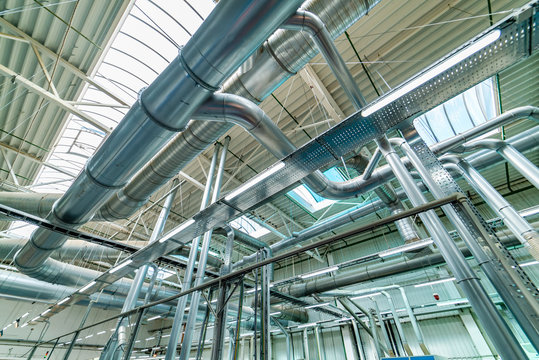 Industrial zone. Steel pipelines, valves, cables and walkways