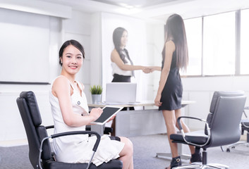modern business woman stand in office with Colleagues are working, business teamwork concept.