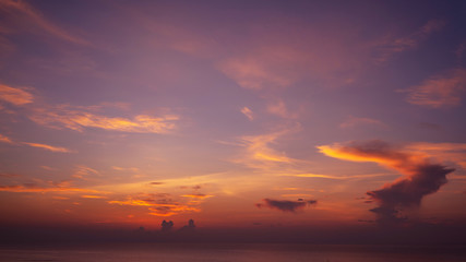 Orange blue sky and clouds above the sea. Morning  sky with clouds and sun