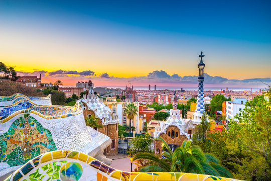 View of mosaic tile and Barcelona cityscape in park Guell at sunset   Spain