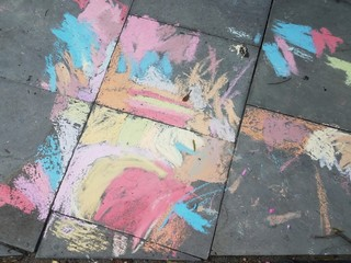 colorful chalk on grey stones