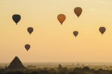 The beautiful scenery view of hot air balloons flying over Sulamani temple one of the most beautiful pagoda in Bagan during the sunrise in Myanmar. The pagoda damaged after the big earthquake 2016.