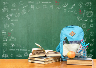 Back to school concept with school books, textbooks, backpack and stationery supplies on classroom...
