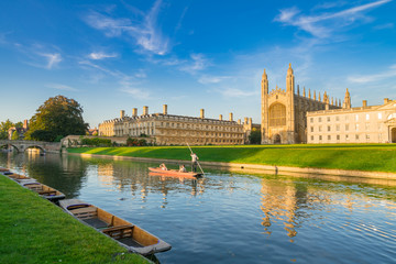 Beautiful view of college in Cambridge with people punting on river cam Wall mural