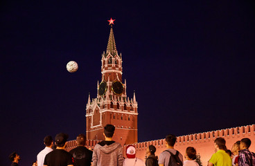 World cup football fans and guests play with the ball on the Red Square near Kremlin in Moscow Russia