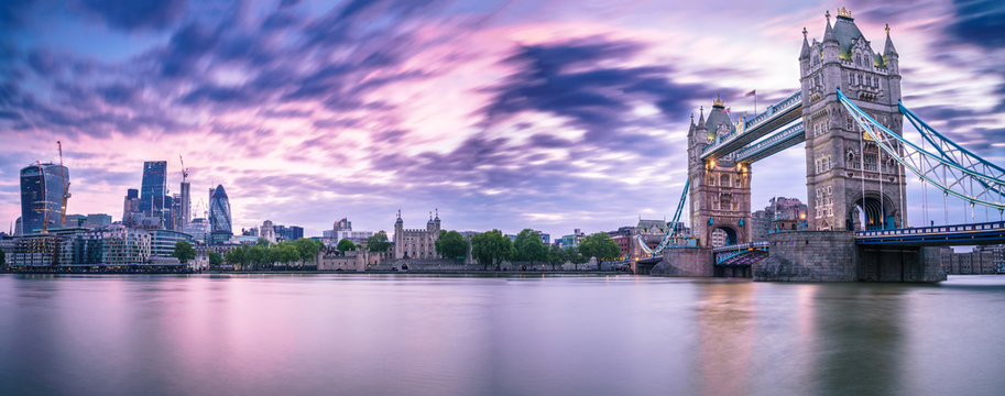 Sunrise panorama of London Tower Bridge and skyscrapers in financial district in London, UK