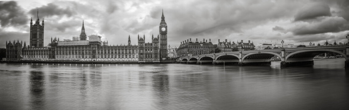 Waterfront view of Palace of Westminster in black and white