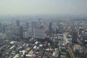 Fototapete - Aerial view of modern office building tower, skytrain railway station and skyscraper in Bangkok Thailand