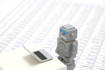 ロボットとパソコンと表 人工知能イメージ