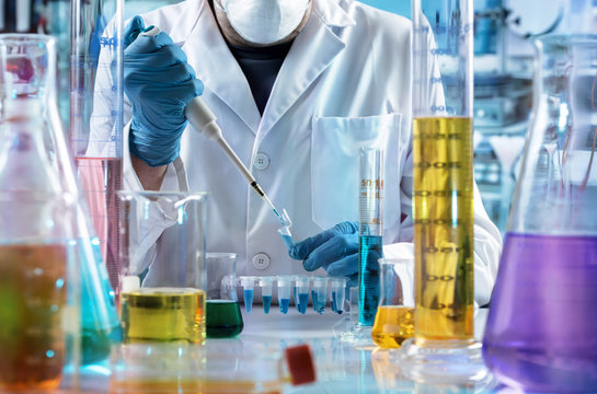 chemical engineer working in the research laboratory / researcher holding test tube with chemist material in the investigation lab