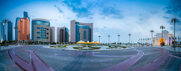 Beautiful evening panorama of skyscrapers and presidential palace in Abu Dhabi, UAE
