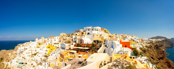 Foto op Aluminium Santorini Panoramic view of Oia town, Santorini island, Greece Traditional and famous white houses and churches with blue domes over the Caldera, Aegean sea