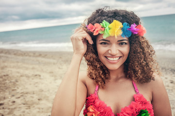 Beautiful Hawaiian woman portrait smiling widely at the beach