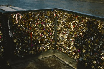 Romantic padlocks placed on bridges by couples of lovers in love who chain their destinies