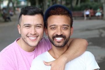 Interracial gay couple outdoor close up